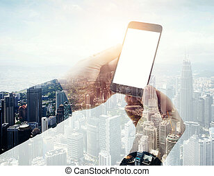 Double exposure photo businessman holding modern smartphone hands. Panoramic view contemporary city and clouds background. White blank screen ready for your business information.Horizontal mockup
