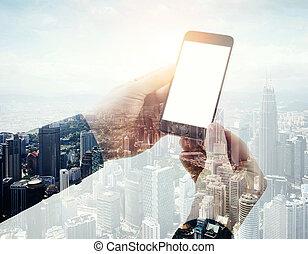 Double exposure photo businessman holding modern smartphone...