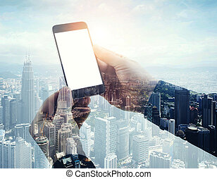 Double exposure photo modern smartphone holding male hands. Panoramic view contemporary city and clouds background. White blank screen ready for your business information.Horizontal mockup.