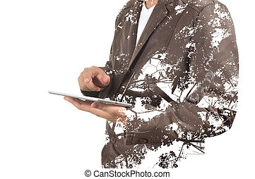 Double exposure portrait of Business man using digital tablet with tree