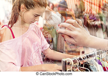 double exposure, teenage girl looking for clothes at a flea...
