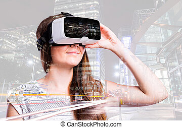 Double exposure. Woman with virtual reality goggles. Night ...