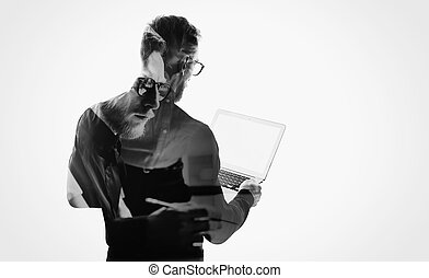 Double exposure young bearded businessman wearing black shirt and holding contemporary notebook hands.White empty screen ready for you message.Isolated white,portrait man background.Horizontal mockup