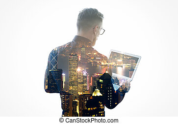 Double exposure young bearded businessman wearing black shirt, glasses and holding contemporary notebook hands. Isolated white, night city background. Horizontal mockup, color