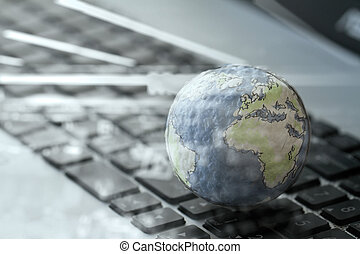 double exposurre hand drawn texture globe on laptop computer as internet concept