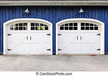 Double garage doors - Two white garage doors with windows on...