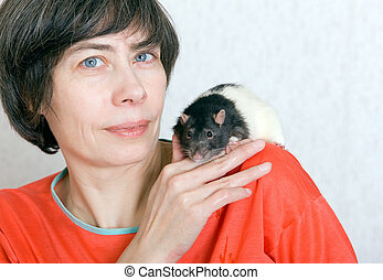 The woman with a spotty little rat on her shoulder