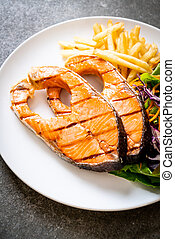 grilled salmon steak fillet with french fries
