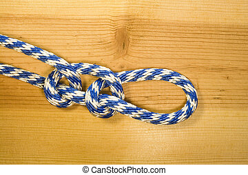 double half hitch knot on a wood background