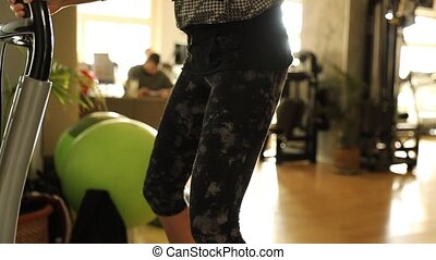 Double leg knee bend - Slow motion detail on fit woman legs...