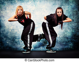 double - Modern teenage girls dancing hip-hop at studio.