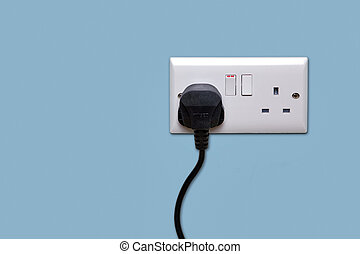 Double power socket and single plug switched on - Double...