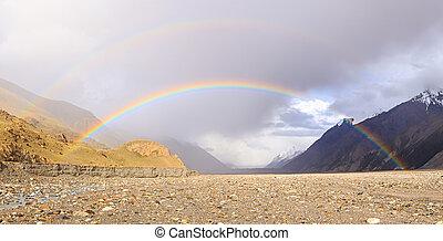 Double rainbow across the valley. Kyrgyzstan, Tien Shan