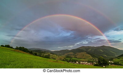 Double Rainbow over Green Meadow and Rural Landscape with Cloudy Sky Time Lapse