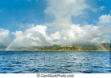 Double rainbow over the caribbean island view from the sea, Saint Pierre, Martinique,  French overseas department