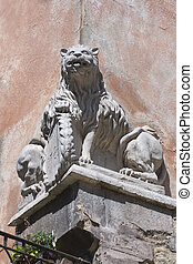 double-sided split statue of a lion on the house corner