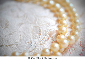 Double strand of pearls on lace