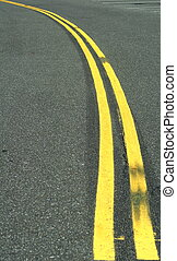 a double yellow curved line freshly painted