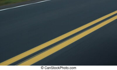 Double yellow lines. Car passes.