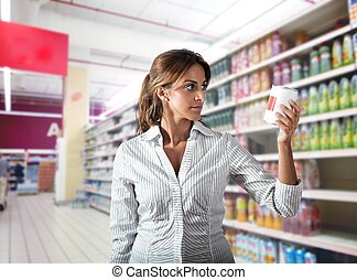 Doubt about food - Girl at supermarket with doubt about food