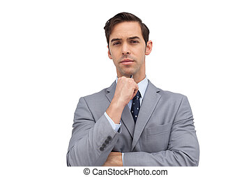 Doubtful businessman looking at camera