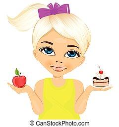doubtful little girl holding an apple and dessert - portrait...