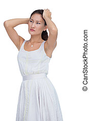 Doubtful woman looking away on white background