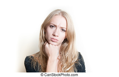 Doubtful young blonde woman portrait isolated