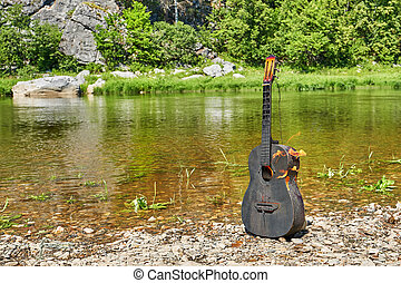 Dougara guitar against the backdrop of nature. Incendiary...
