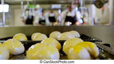 Dough ball arranged on tray in kitchen 4k - Close-up of ...
