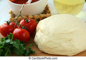 dough, tomato sauce, olive oil and tomato pizza ingredients
