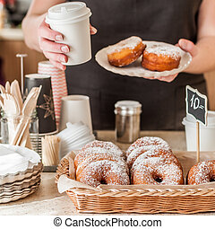 Doughnut Store Counter, Donuts with Icing Sugar in a Display...