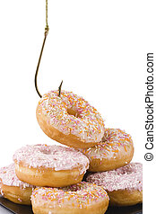 Doughnuts being hooked on a white background