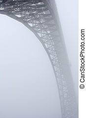 Douro river old bridge in the mist
