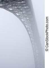 Douro river old bridge in the mist