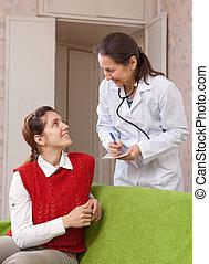 doutor amigável, perguntado, a, paciente, sente