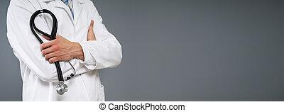 doutor masculino, segurando stethoscope, close-up