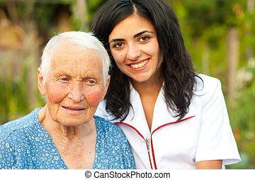 doutor mulher, idoso, ao ar livre