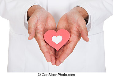 doutor, segurando, forma coração, símbolo