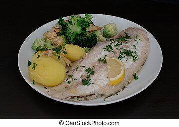 Dover sole fish dinner with potatoes, broccoli (romanesco ...