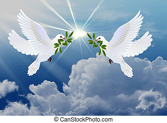 Doves of peace with olive branch symbol of Easter