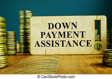 Down Payment Assistance sign on a wooden plate.