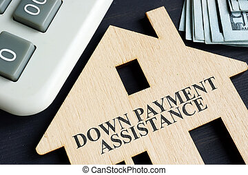 Down payment assistance written on a model of home.