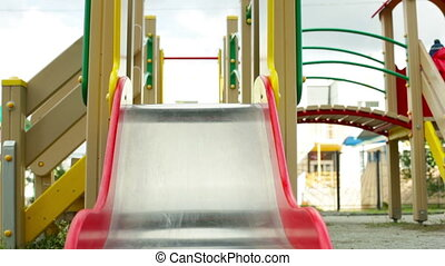 Down the chute - Active lad sliding down the chute on the...