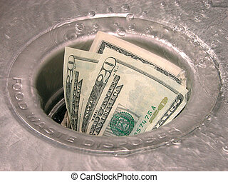Down the Drain - Money in a garbage disposal with water...