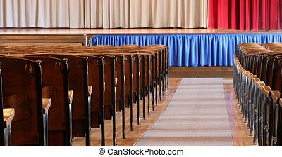 Isle, seats and curtains in an old auditorium