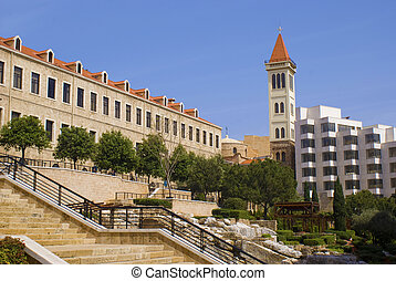 a side of downtown beirut showing a garden and a church