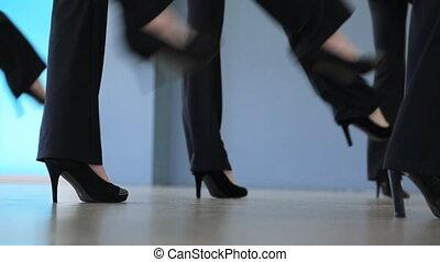 Down view of women dancing in model school.