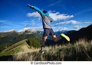 Downhill race on mountain terrain an athlete during a workout
