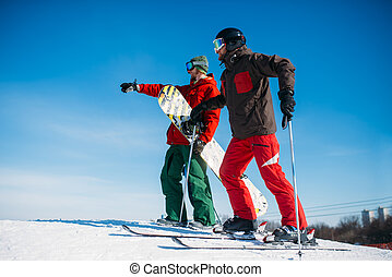 Downhill skiing, skiers on the top of slope